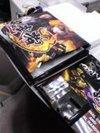 鬼武者3の販促グッズ。左上がクッション、真中下よりにイヤフォンマイク2点セット(ちょと見づらい)